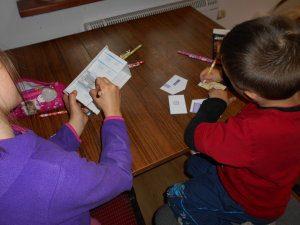 kids making papercraft models